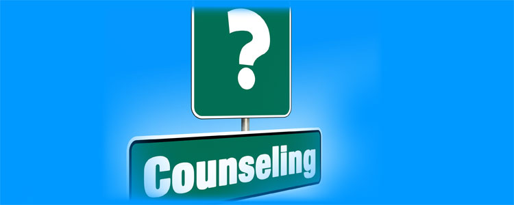 "Image of green road sign with question mark and ""counseling?"""